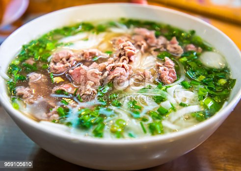 Delicious Vietnamese pho, a soup made of beef or chicken broth and rice noodles. Shot at Pho 10, Ha Noi.