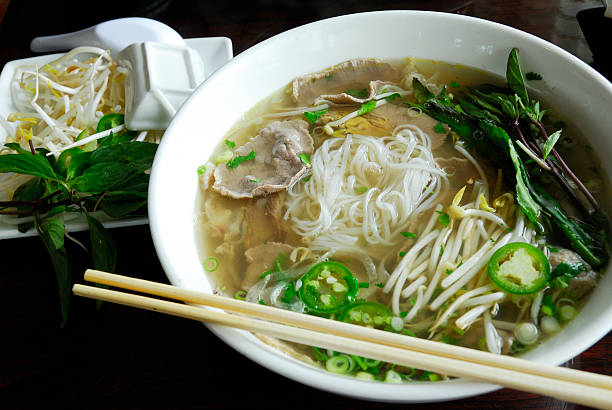 pho noodles - pho soup stock photos and pictures