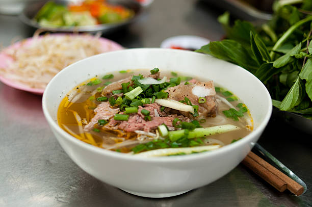 pho - saigon streetfood - pho soup stock photos and pictures