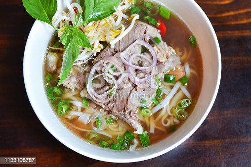 Fresh hot pho soup in a white bowl from traditional Vietnamese cuisine