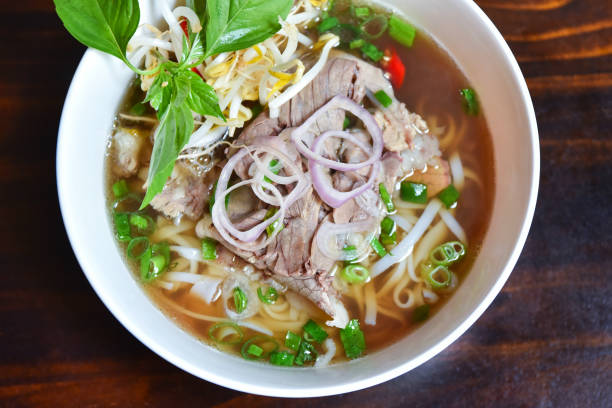 pho soup - pho soup stock photos and pictures