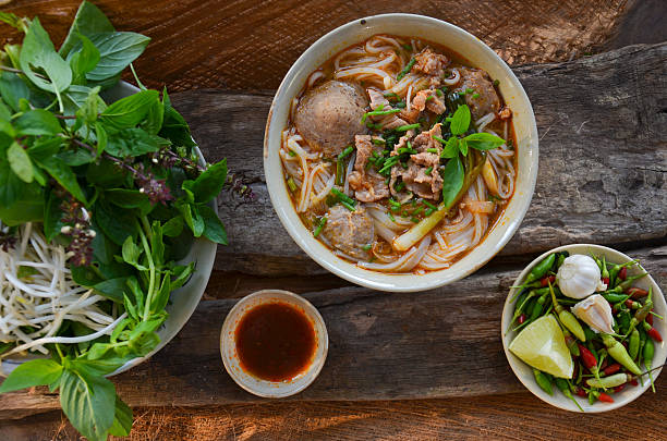 pho vietnamese beef soup on a wooden background - pho soup stock photos and pictures