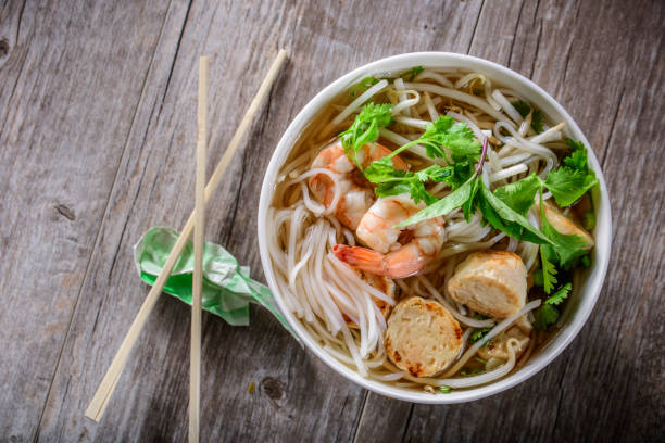 pho, vietnamese soup bowl, with seafood - pho soup stock photos and pictures