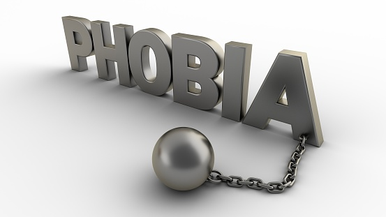 istock Phobia text with chain and weight isolated on a white background. 3D-rendering. 1209736703