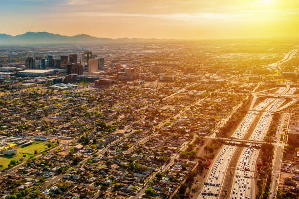 phoenix aerial at dusk - skyline mountains usa stock photos and pictures