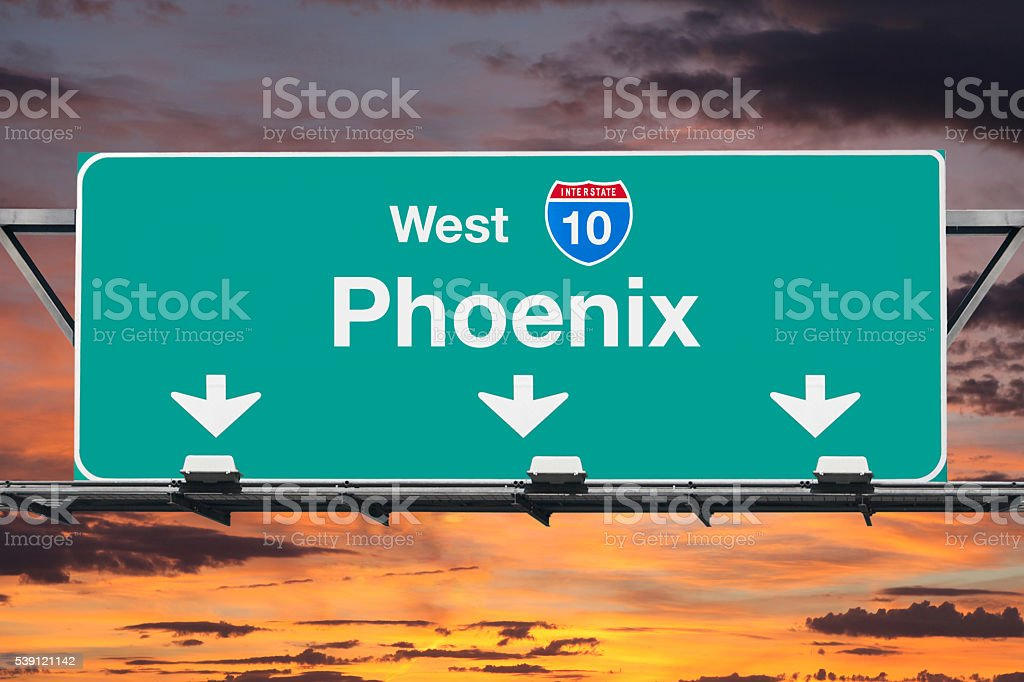 Phoenix Arizona Interstate 10 West Highway Sign with Sunrise stock photo