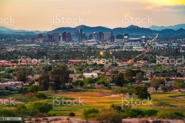 Phoenix arizona skyline at sunset picture id1135712236?b=1&k=6&m=1135712236&s=612x612&h=apu0stlu9nuvoezvuevu3g3jl6rpufzjlj33xkrdod4=