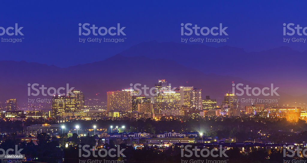 Phoenix Arizona skyline panorama cityscape skyscrapers twilight night, copyspace stock photo