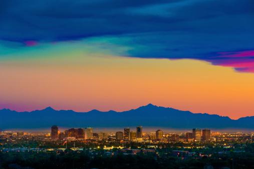 Phoenix Arizona skyline under a dramatic sunset as seen from Scottsdale