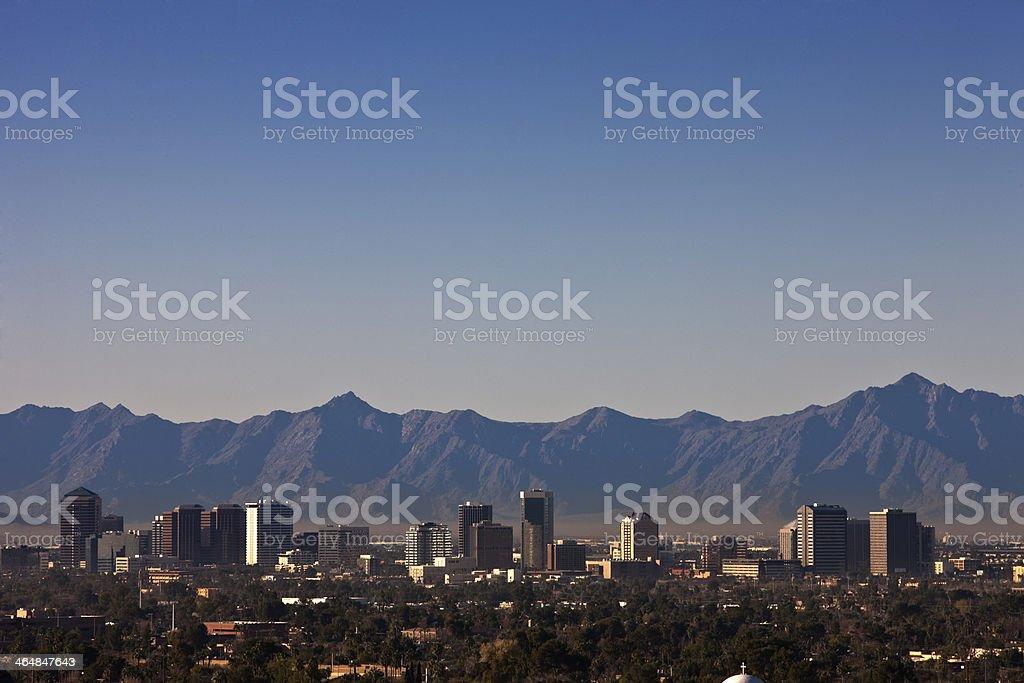 Phoenix Arizona skyline with mountains in the distance stock photo