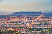 Phoenix, Arizona, USA downtown cityscape from above at dusk.