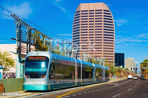 Phoenix Metro Light Rail Train with Midtown Phoenix buildings in the background.