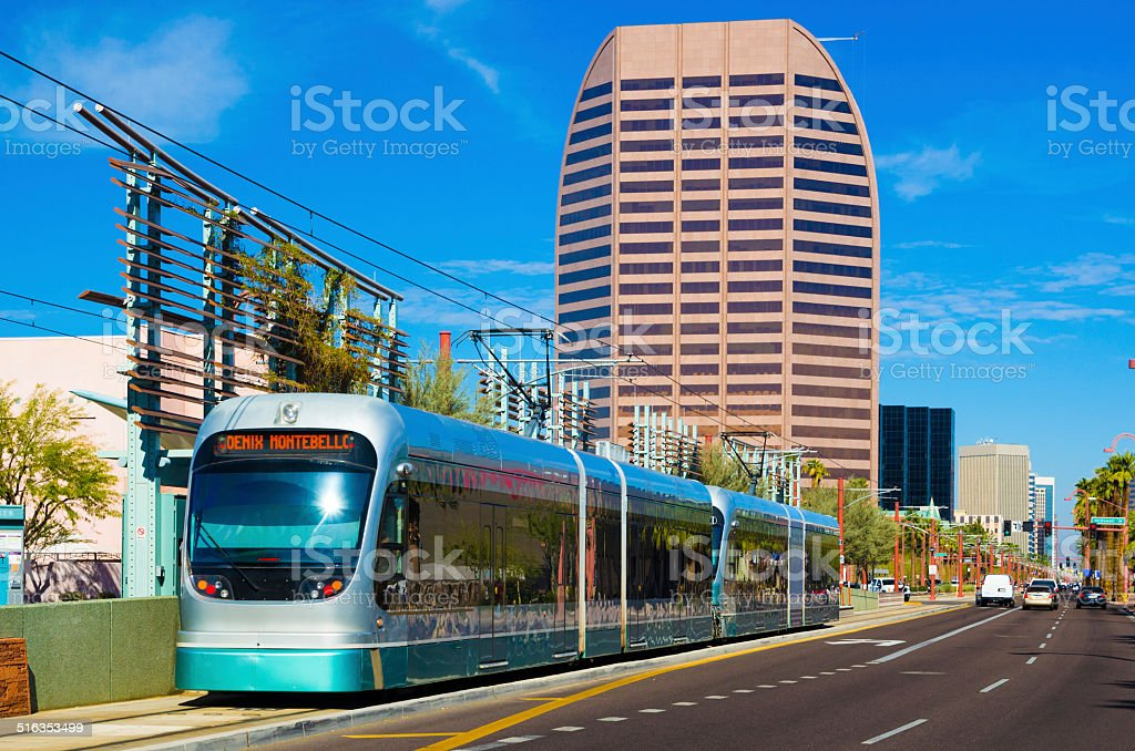 Phoenix Metro Light Rail train and Midtown stock photo