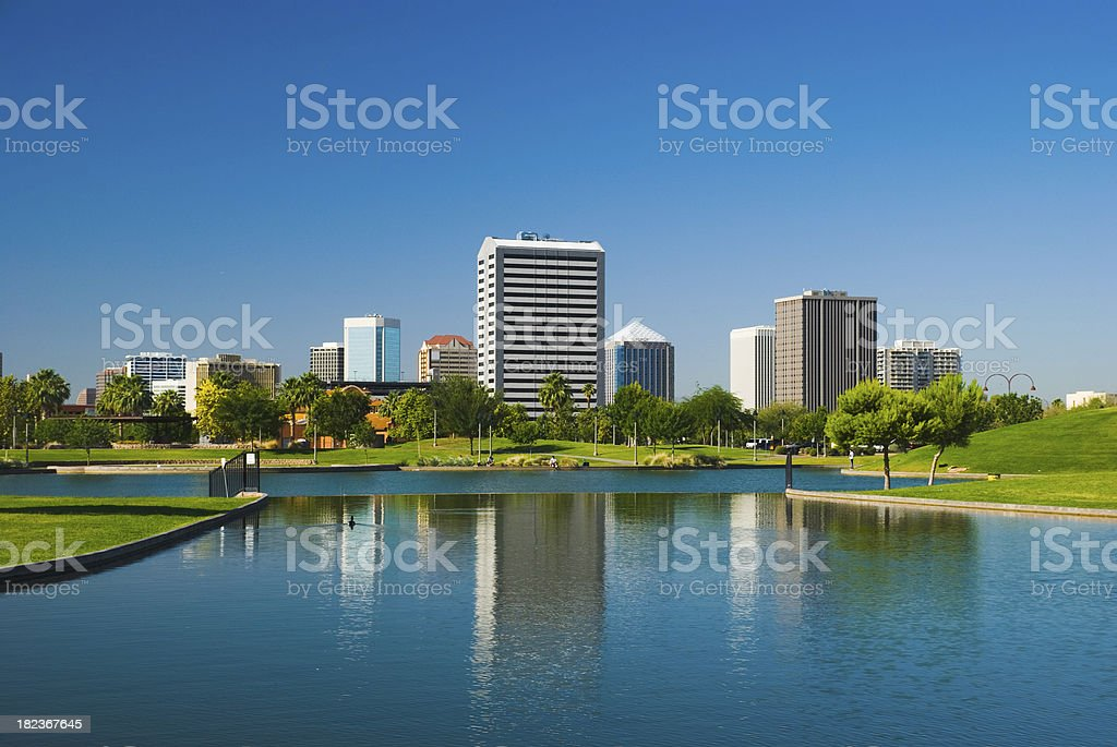 Phoenix Midtown skyline, park, and lake royalty-free stock photo