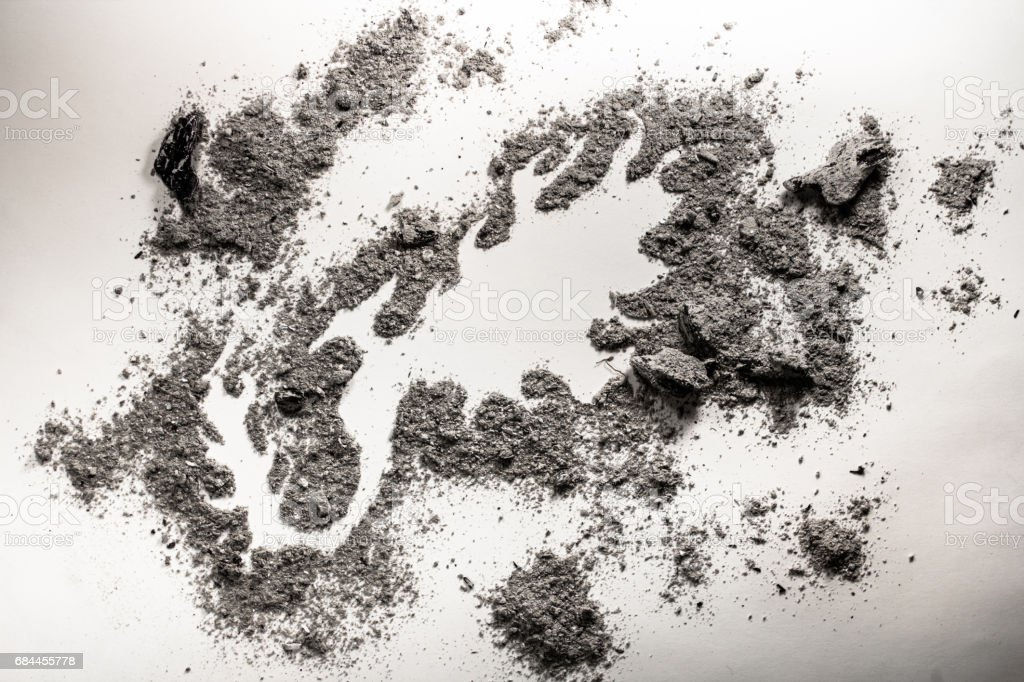 Phoenix mythical bird drawing made in grey pile of ash as a rebirth - foto de stock