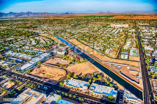 Aerial view of a canal passing through a residential district in suburban Phoenix, Arizona.