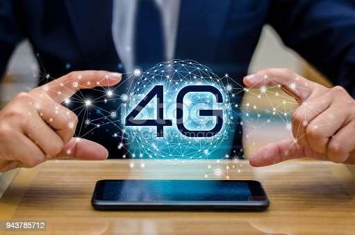istock phone 4g Earth businessman connect worldwide waiter hand holding an empty digital tablet with smart and 4G network connection concept 943785712
