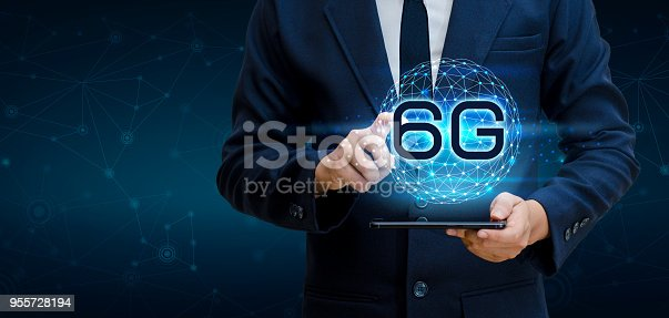 1062274518 istock photo phone 6g Earth businessman connect worldwide waiter hand holding an empty digital tablet with smart and 6G network connection concept 955728194