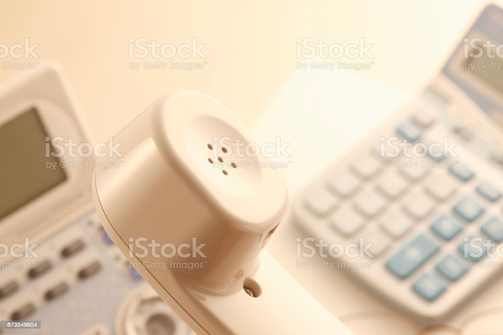 Phone and calculator royalty-free stock photo