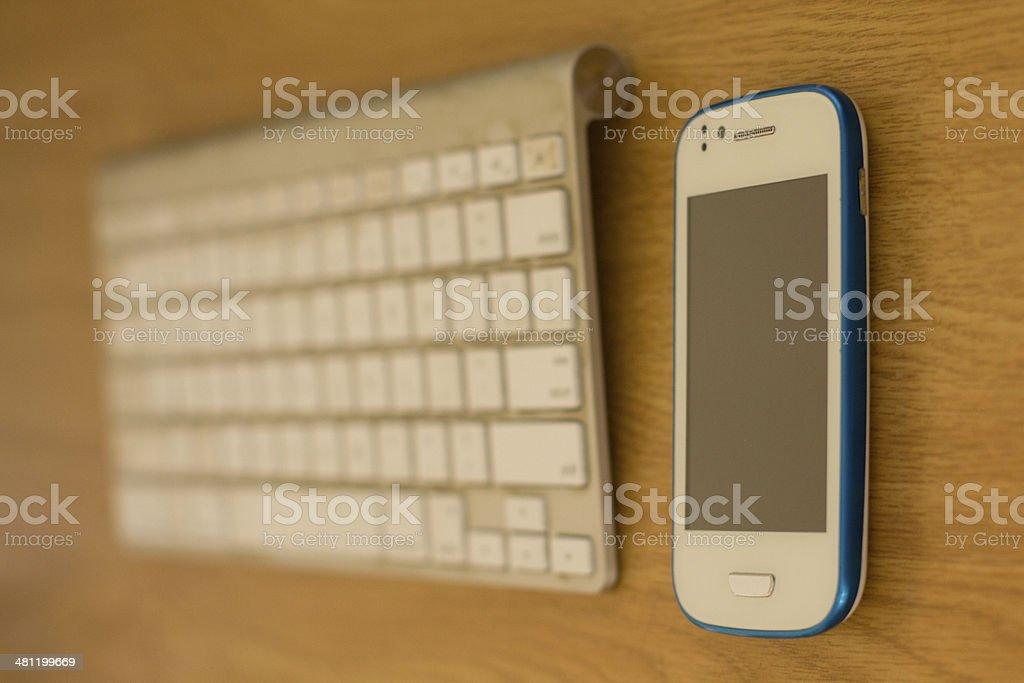 Phone and keyboard royalty-free stock photo