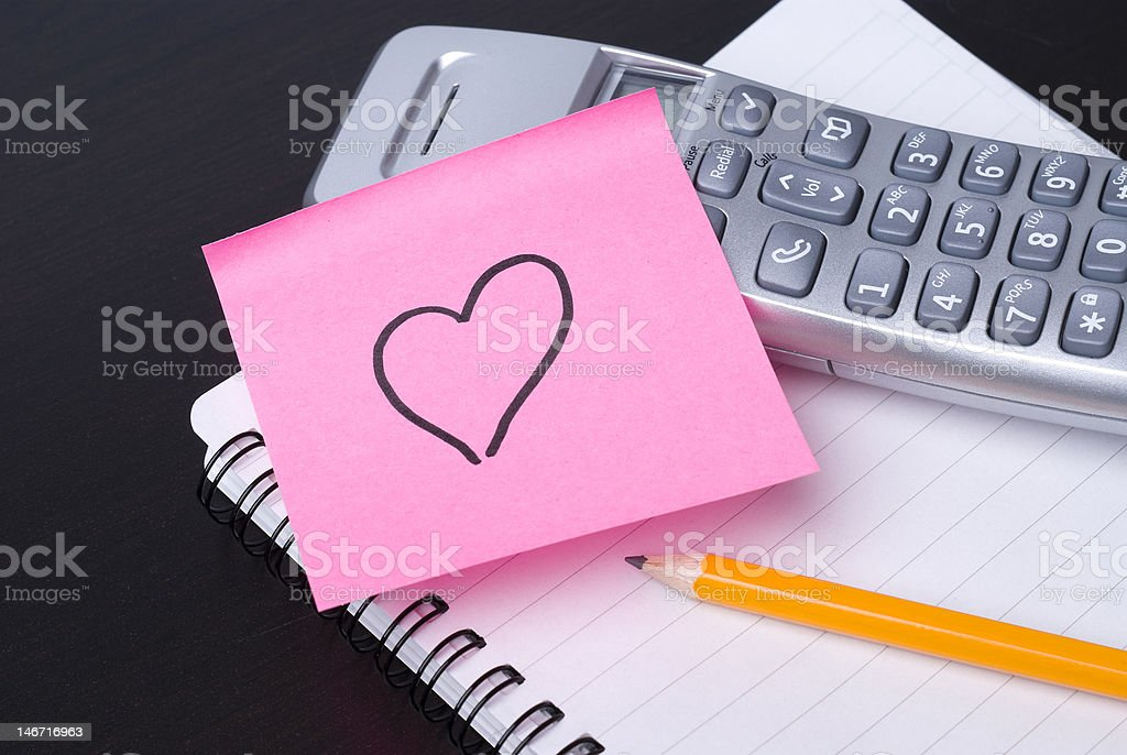 Phone and pink HEART postit royalty-free stock photo