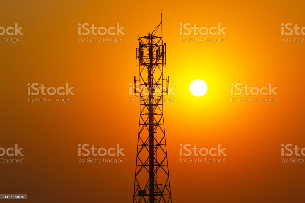 Phone Antenna Tower with a sunset background Silhouette-Evening light