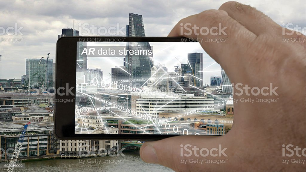 AR phone app showing binary data flying round London. stock photo