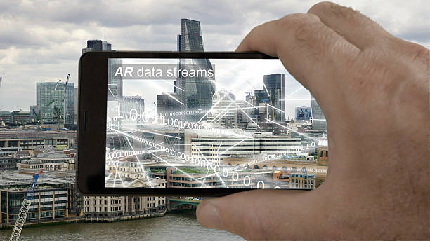 Cтоковое фото AR phone app showing binary data flying round London.