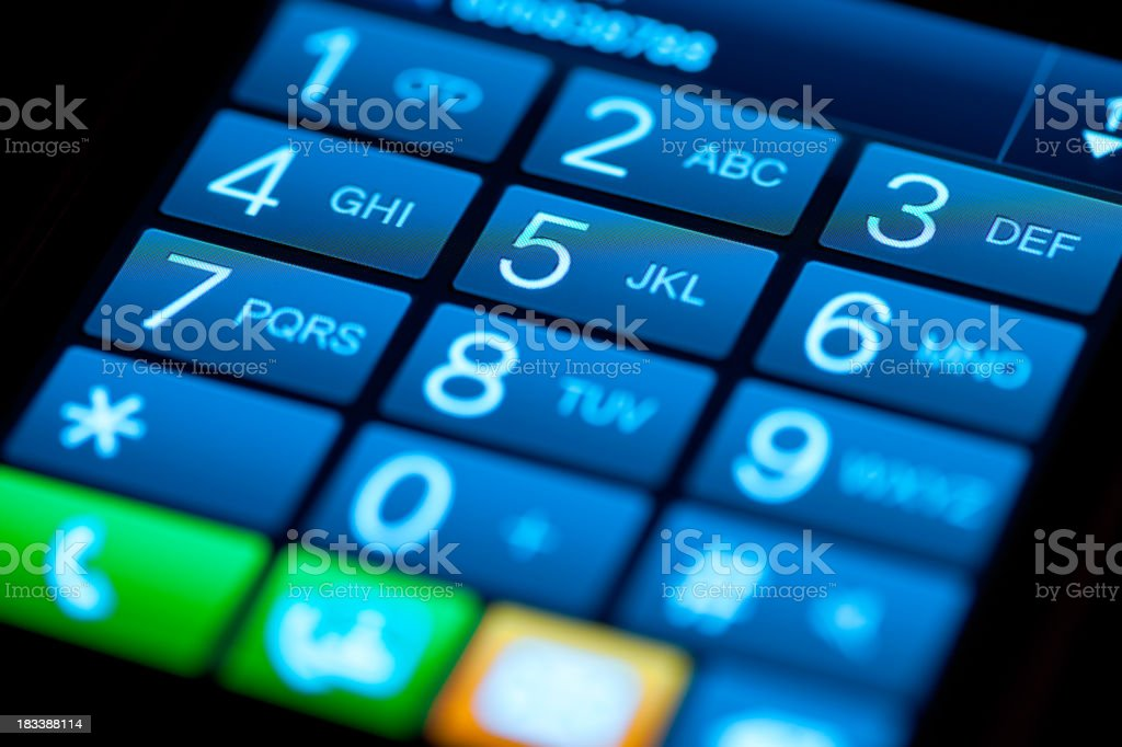 Phone blue touchscreen keypad photographed with shallow depth of field royalty-free stock photo