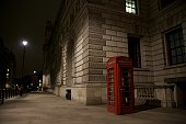 a lonely phone booth at the mid in the center of london