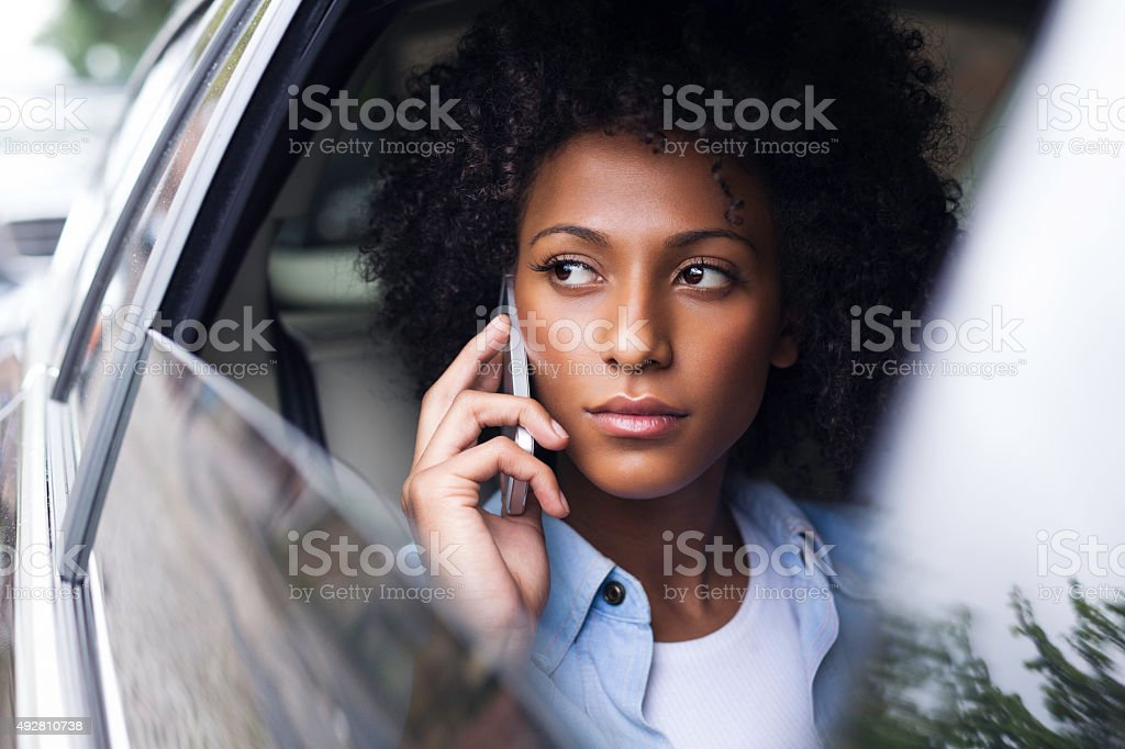 Phone Call in the Back Seat stock photo