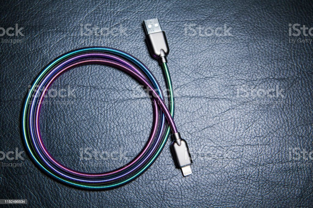 phone charger cable leather background