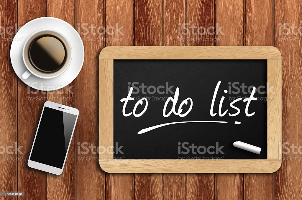Phone, Coffee And A Chalkboard Written To Do List stock photo