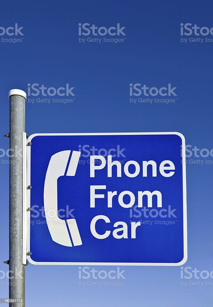 Phone From Car Sign against a Clear Blue Sky royalty-free stock photo