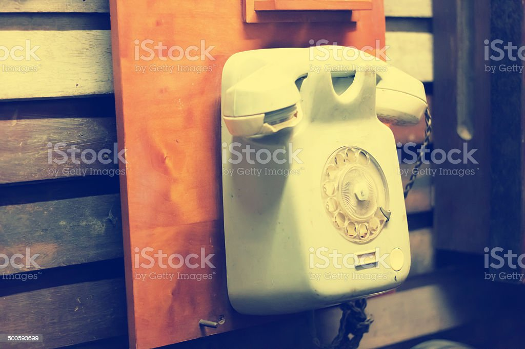Phone hangs on a wall royalty-free stock photo
