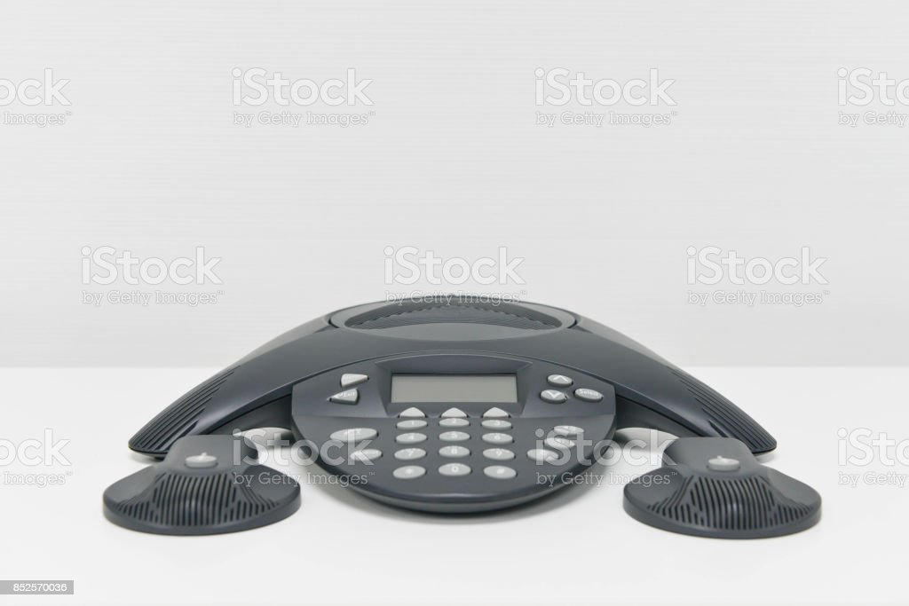 IP Phone - IP Conference device on the white table with mic stock photo