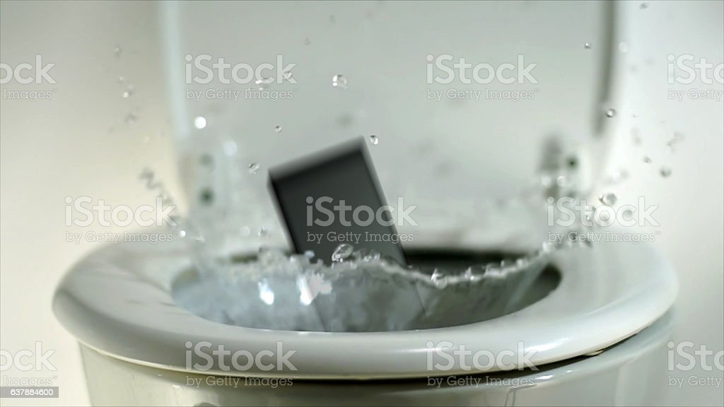 Phone landing in a toilet bowl. stock photo