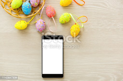 istock phone mockup with plants. invitation card with environment and quail eggs. easter eggs, ribbons and nest on white background 1142647308