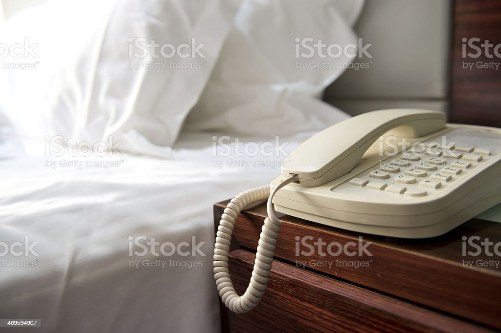 phone near a bed stock photo