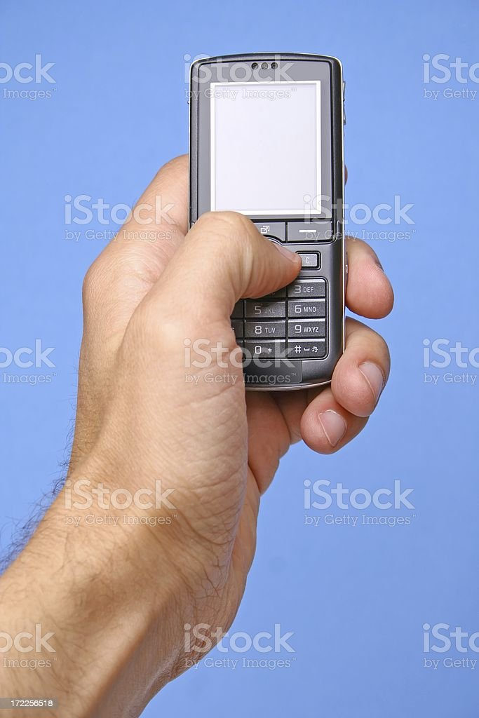 Phone on blue background royalty-free stock photo