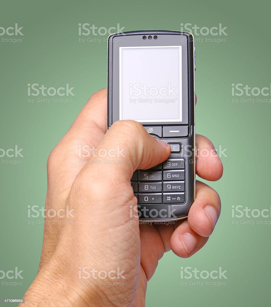 Phone on green background stock photo