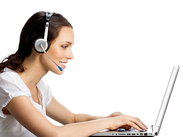 Phone operator in headset with laptop, isolated stock photo