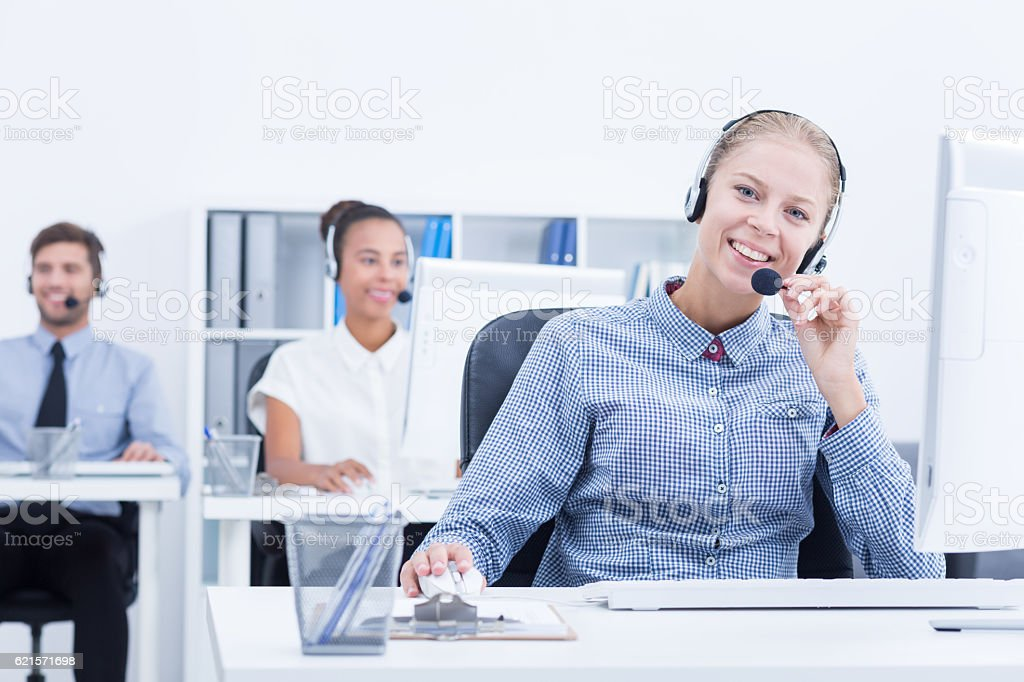 Phone operator in light office photo libre de droits