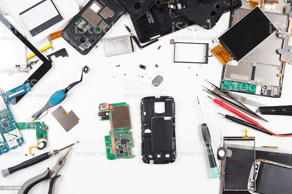 Телефон ремонт вид сверху стоковое фото