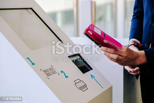 istock phone scans a code on an information computer 1187600584