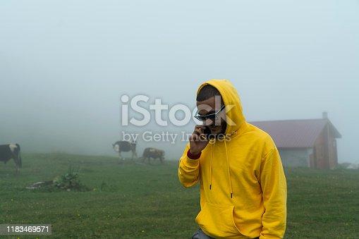 Yellow raincoat nature man