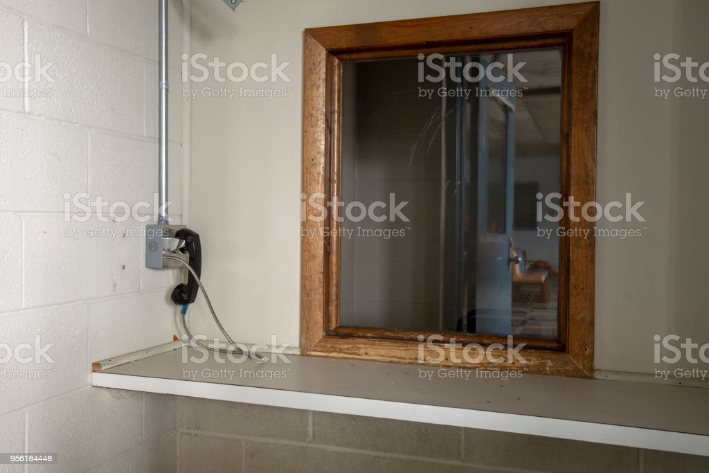 Phone used by visitors at abandoned prison stock photo