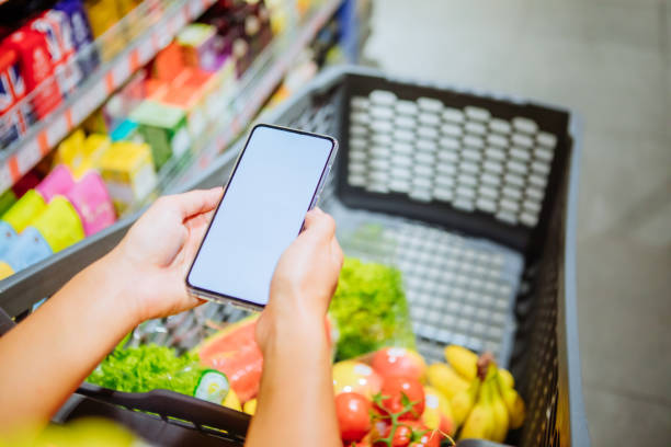 phone with empty blank white screen shopping cart on background copy space stock photo