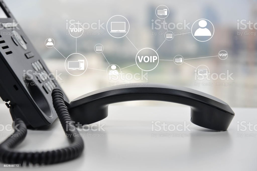 IP Phone with icon - cencept for phone connected to multi device stock photo