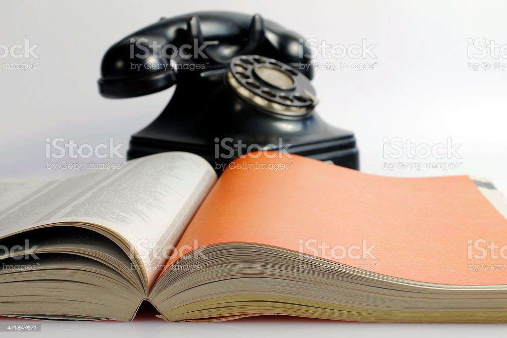 Phonebook and old black phone royalty-free stock photo
